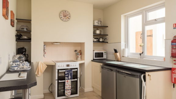 Kitchen with breakfast bar, fridge and freezer
