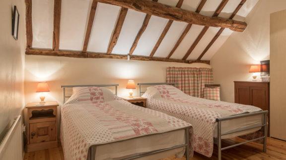 First floor twin bedroom with original exposed beams