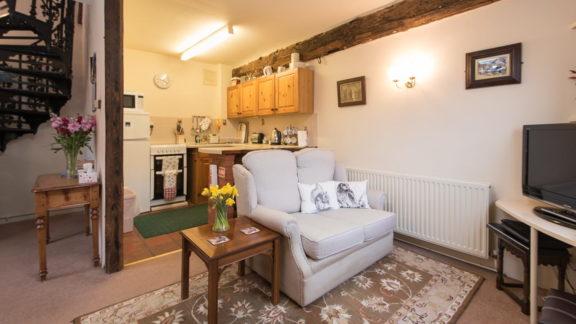 The open-plan kitchen / breakfast bar / living room