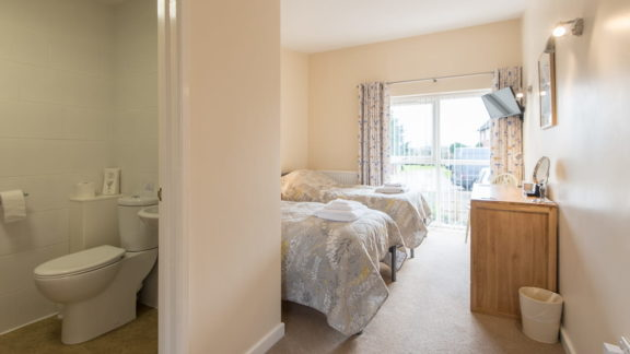 Two single beds and en-suite with shower