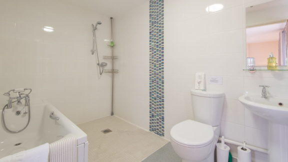 en-suite with bath and walk-in shower