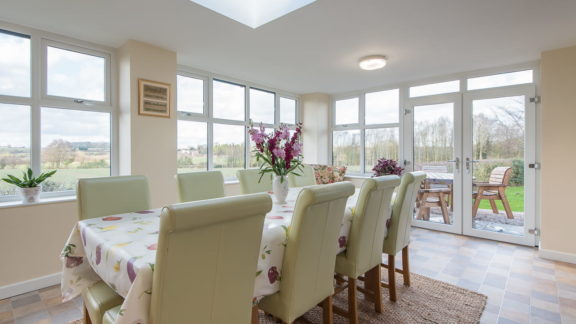 The dining room, with views of surrounding fields