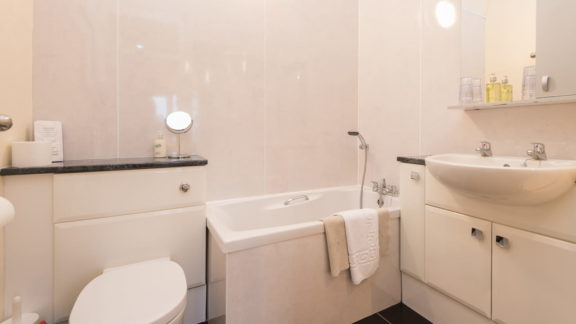 Bathroom - with compact bath and shower