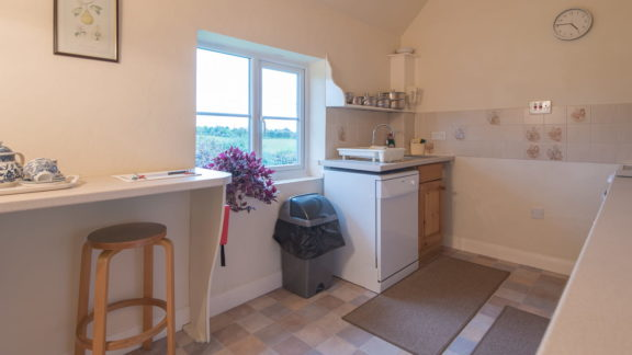 The kitchen - with breakfast bar, dishwasher, and view!